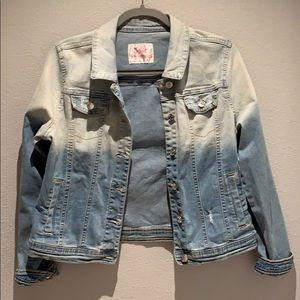 Light blue jean jacket with attached price tag